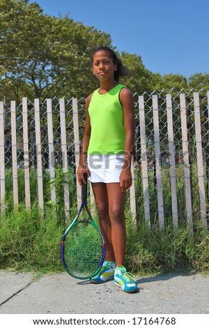 13 year old girl playing tennis - stock photo