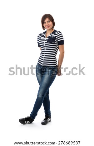 25 year old girl wearing a blue and white striped jeans in the studio. Isolate on white. - stock photo
