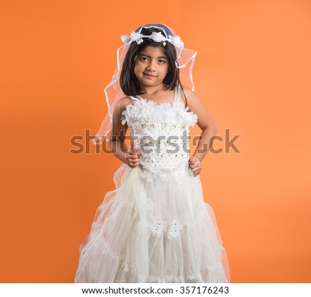 4 year old indian girl in party wear, indian girl in white birthday gown, birthday dress and small asian girl, indian girl in princess dress, white dress with frills - stock photo
