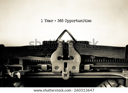 1 year = 365 opportunities, motivational message typed on vintage typewriter - stock photo