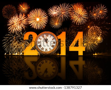 2014 year with fireworks and clock displaying 5 minutes before midnight - stock photo