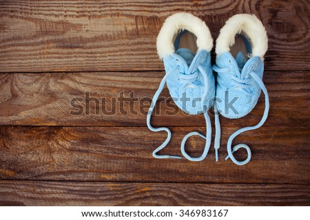 2016 year written laces of children's shoes on old wooden background. Toned image  - stock photo