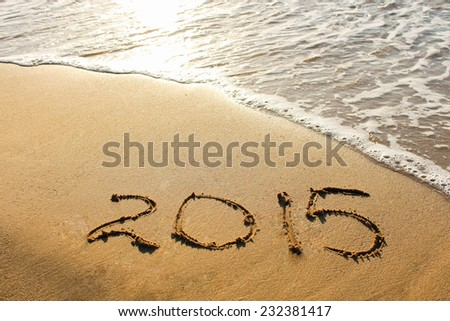 2015 year written on sandy beach - stock photo