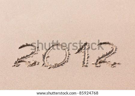 2012 Year written on the beach sand - stock photo