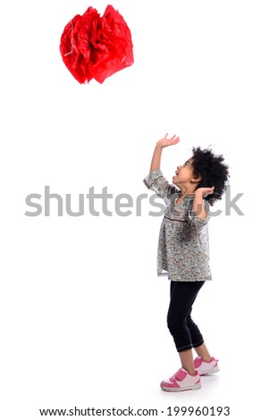 5-6 years african girl racing her hands to catch a paper ball shot in a studio on a white background - stock photo