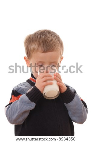 4 years old boy and glass of milk isolated on white - stock photo