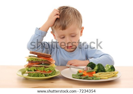 3-4 years old boy and hard choice isolated on white - stock photo