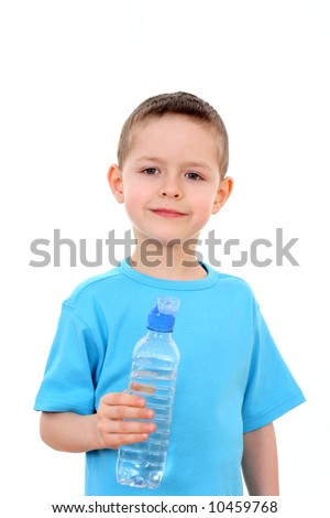 6 years old boy with bottle of water isolated on white - stock photo