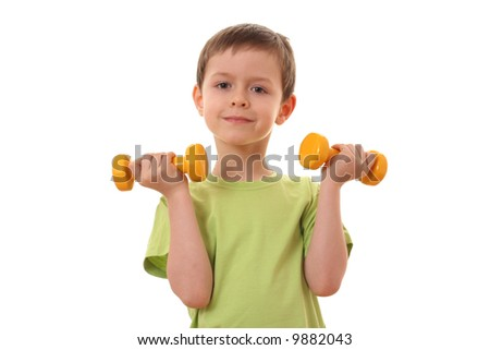 6 years old boy with dumbbells isolated on white - stock photo