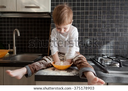 5 years old child cooking holiday pie in the kitchen, casual still life photo series, surprise for mom - stock photo