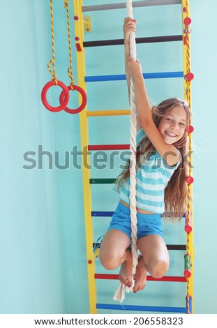8 years old child playing on sports equipment - stock photo