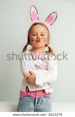 4 years old girl acting as a little easter bunny. - stock photo