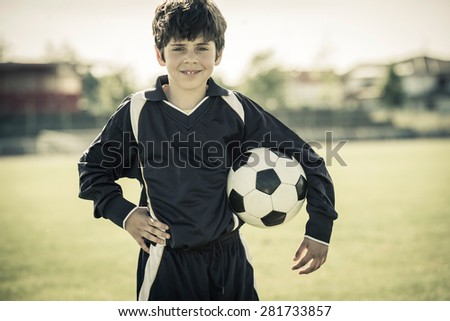8 years old girl holding soccer ball - stock photo