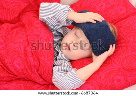 3-4 years old preschooler in bed - sick - stock photo