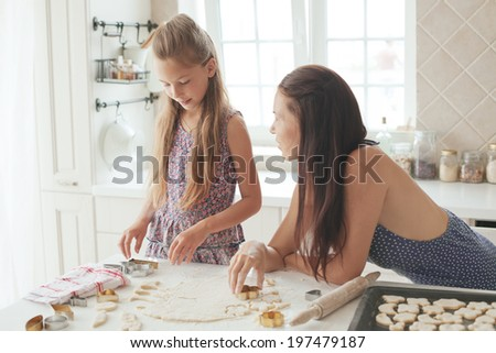 7 years old school girl cooking at the kitchen, casual lifestyle photo series - stock photo