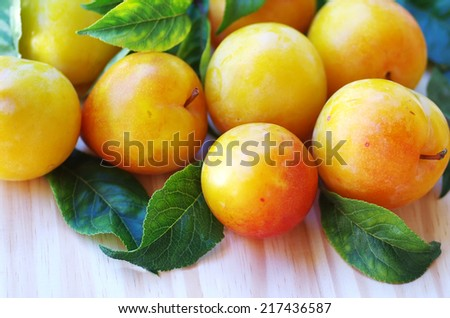 yellow plums on table - stock photo
