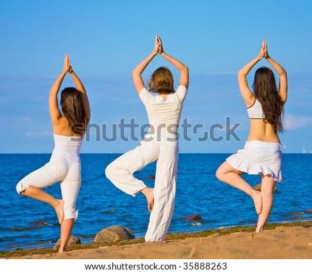 3 yoga girls - stock photo