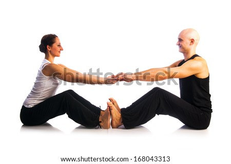Yoga seria: Couple in Paschimottanasana Pose, Seated Forward Bend Pose or Intense Dorsal Stretch Pose is an asana isolated on white background - stock photo
