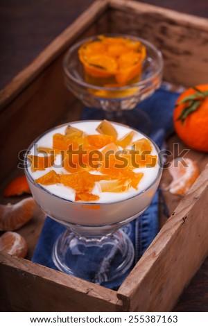 Yogurt with Mandarin jelly,homemade dessert.selective focus - stock photo