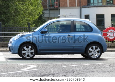 YORK, UK - CIRCA AUGUST 2015: light blue Nissan Micra car in a street of the city centre. - stock photo