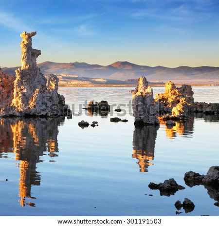 Yosemite National Park, USA. Outliers -  bizarre calcareous tufa formation  reflected in the mirrored surface of the water. The picturesque sunset at Mono Lake - stock photo