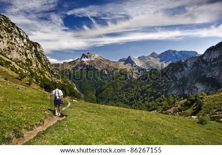 Youn man walk in pyrenees - stock photo