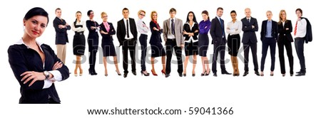 Young attractive business people - the elite business team - lead by a business woman - stock photo