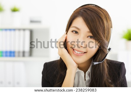 young beautiful business woman in headset - stock photo
