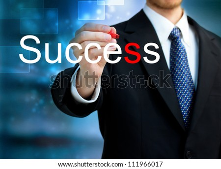 Young business man writing the word Success with red pen - stock photo