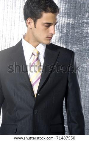 Young businessman in a suit isolated shot in studio - stock photo