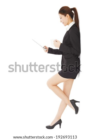 young businesswoman holding tablet and cups  - stock photo