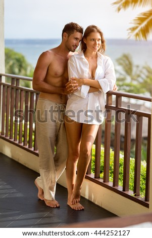 young couple meeting the morning on the balcony - stock photo