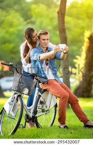 Young couple resting after biking - stock photo