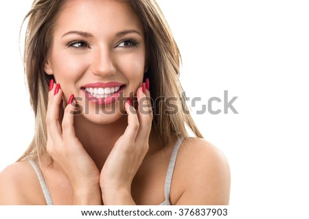 Young cute smiling girl with perfect white teeth on white background - stock photo