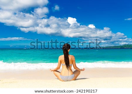Young girl on a tropical beach. Summer vacation concept. - stock photo