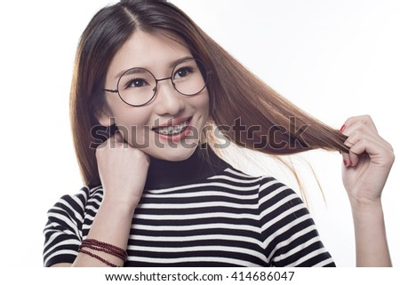 young girl opened her mouth to show braces - stock photo