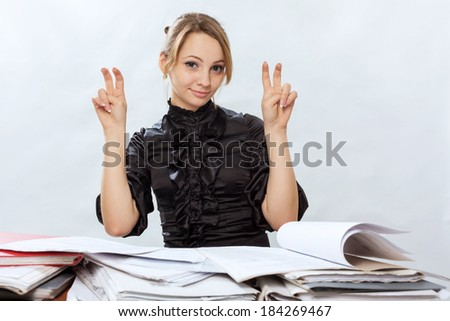 Young girl signs quotation marks by fingers - stock photo