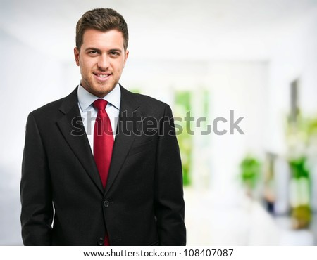 Young handsome businessman portrait - stock photo