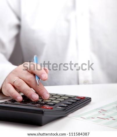 young man calculating bills at home - stock photo