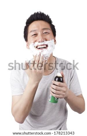 Young man doing shaving - stock photo