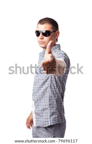 young man in sunglasses shows forefingers isolated on white background - stock photo