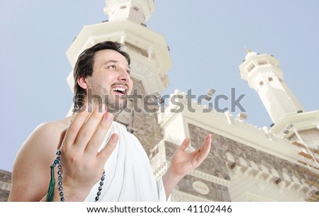 Young man, muslim pilgrim in white traditional clothes - stock photo