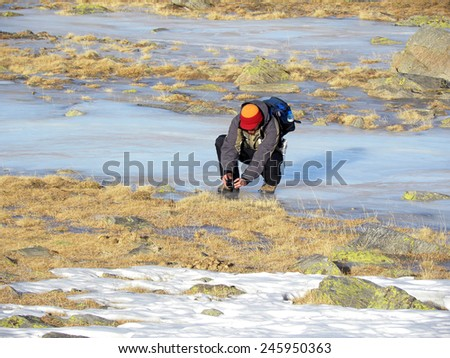 Young Man Taking Photos In The Wilderness                               - stock photo