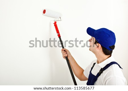 Young painter working - stock photo