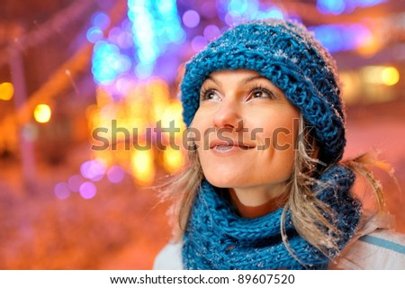 young pretty woman outdoor in winter - stock photo
