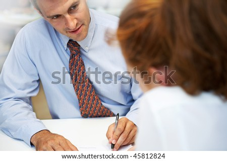 young seller talking to a customer - stock photo
