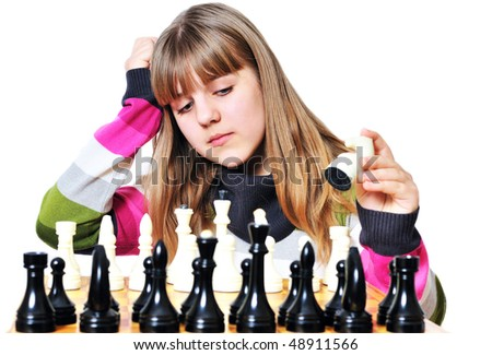 Young teen girl thinking with chess in hand - stock photo