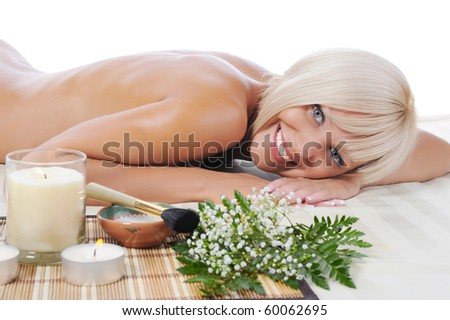 Young woman at spa procedure Isolated on white background - stock photo