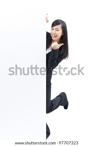 young woman giving thumbs up and holding blank billboard, isolated on white background - stock photo