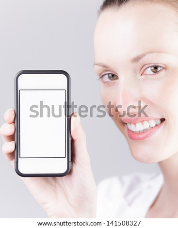 Young woman holding blank smartphone - stock photo